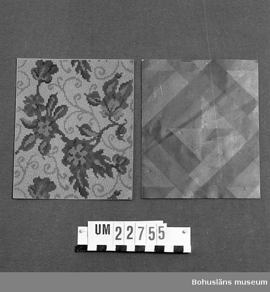 """En st. brun parkettmönstrad. Den andra beige botten flerfärgat blommotiv. Märkt: """"Delmenhorster Linoliumfabrik ANKER-MARKE. Delmenhorst b/Bremen.""""  Neg. UM 135:4."""