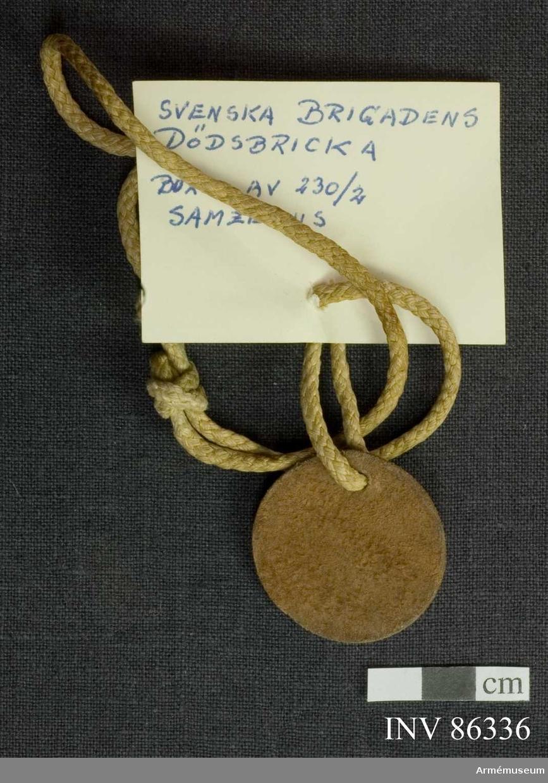 Identitetsbricka för 230/2 Samzelius, Svenska Brigaden.