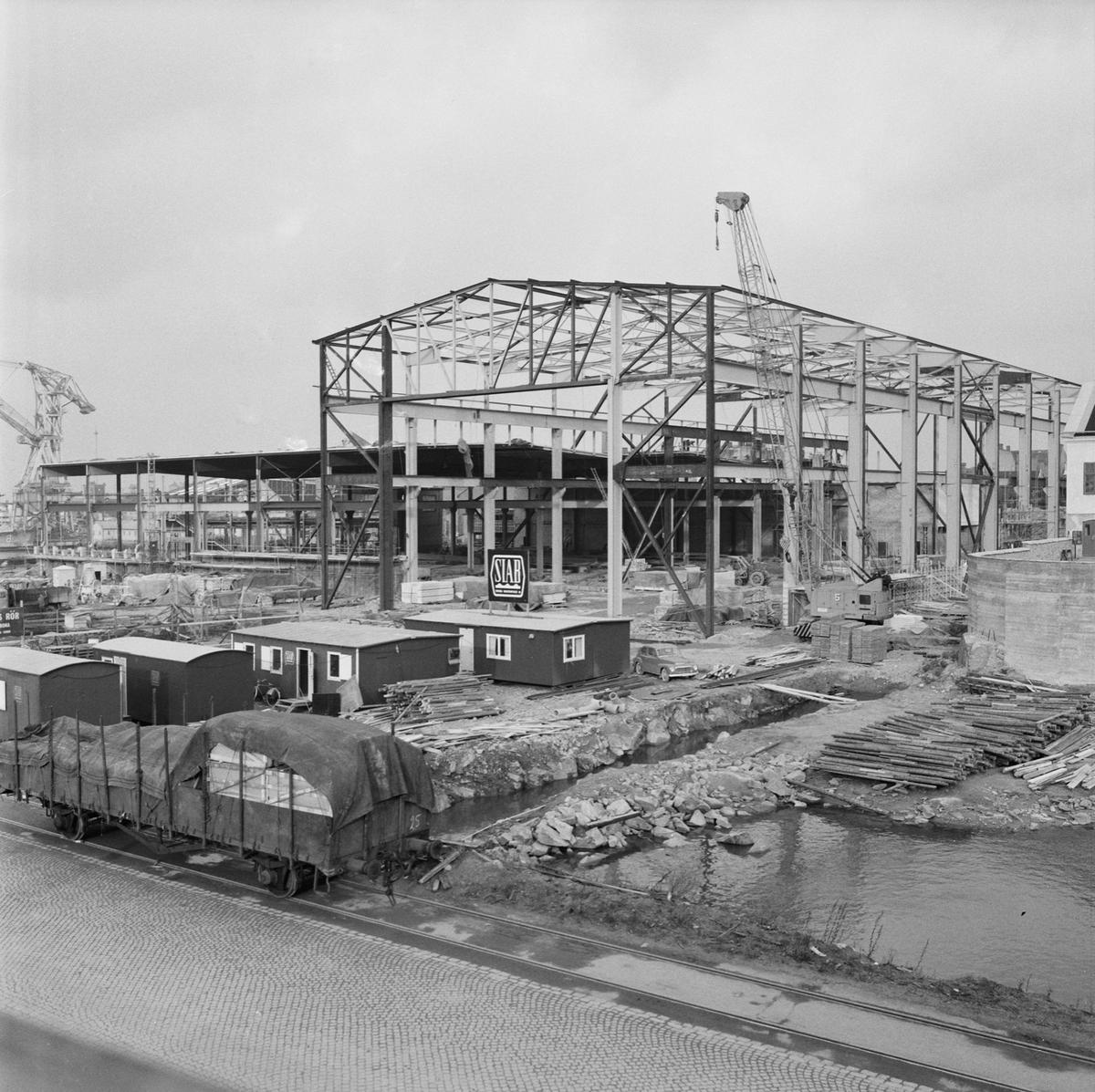 Övrigt: Fotodatum:15/11 1962. Byggnader och Kranar. Nybyggnations område. Kraftcentralen och Plåtverkstan