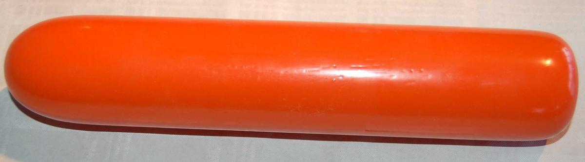 Sylinderformet hode av flytande materiale som festes til pilstammen brukt i eit Kongsberg Redningsgevær M.52.