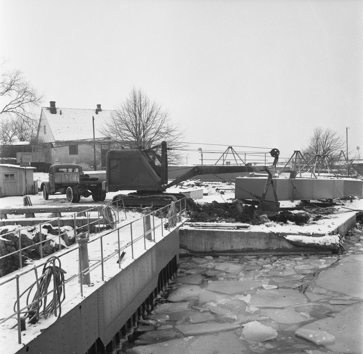 Övrigt: Fotodatum:17/1 1959 Byggnader och Kranar. Polhemsdockan pågående arbete.