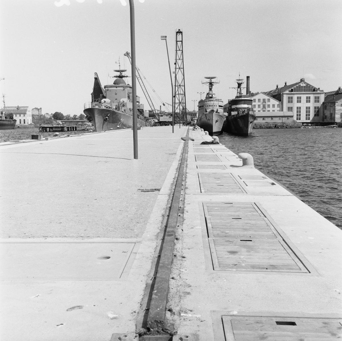 Övrigt: Fotodatum:23/5 1959 Byggnader och Kranar. Nya utrustningspiren (färdig) Närmast identisk bild: V16581, ej skannad