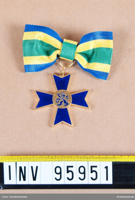Medalj stort blått kors med lejon/grip?