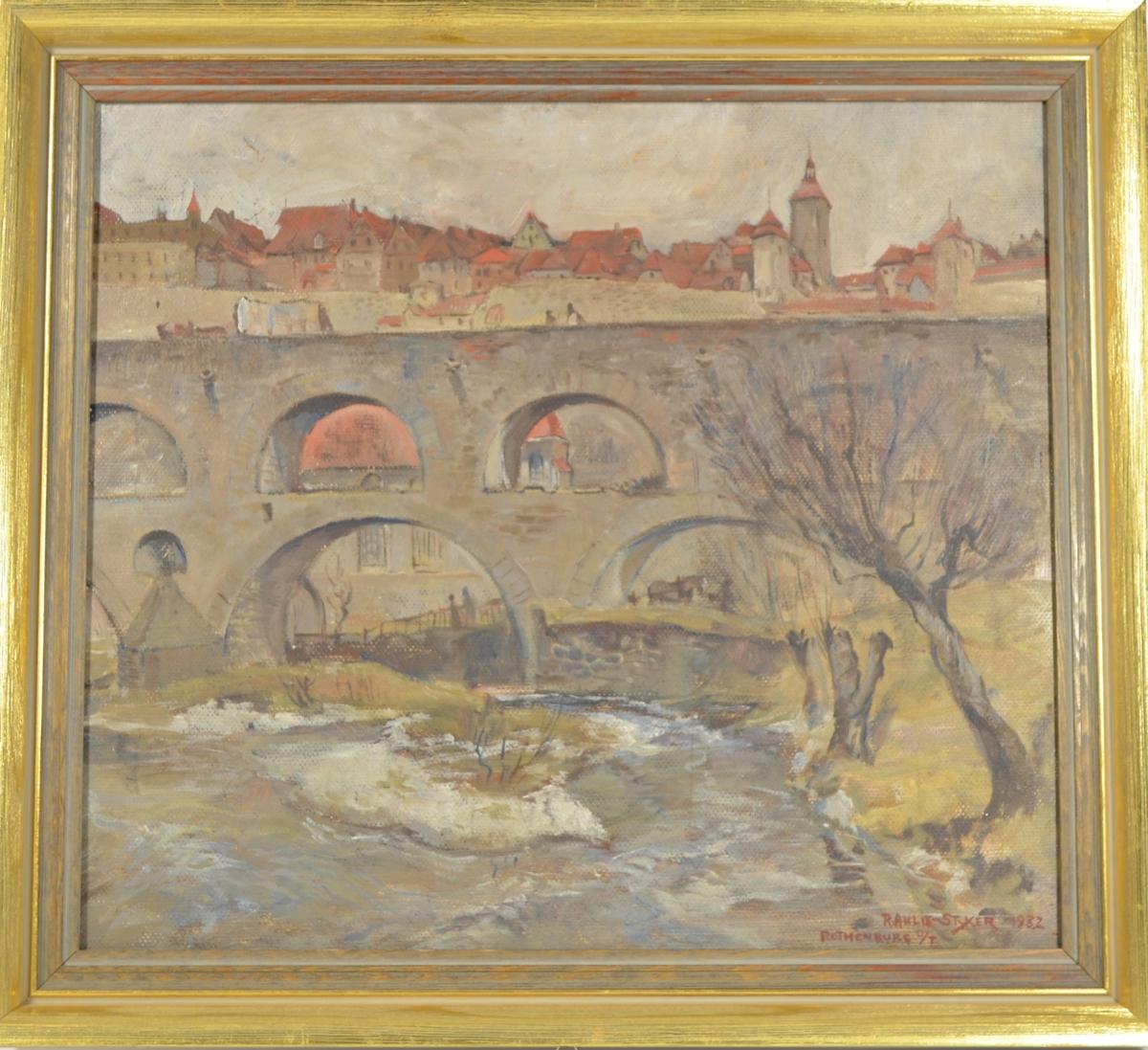 Motivet viser et byprospekt med en to-etasjes bro [akvedukt?] i mellomgrunnen og bebyggelse i bakgrunnen. I forgrunnen ser man en elv og helt til høyre et tre.