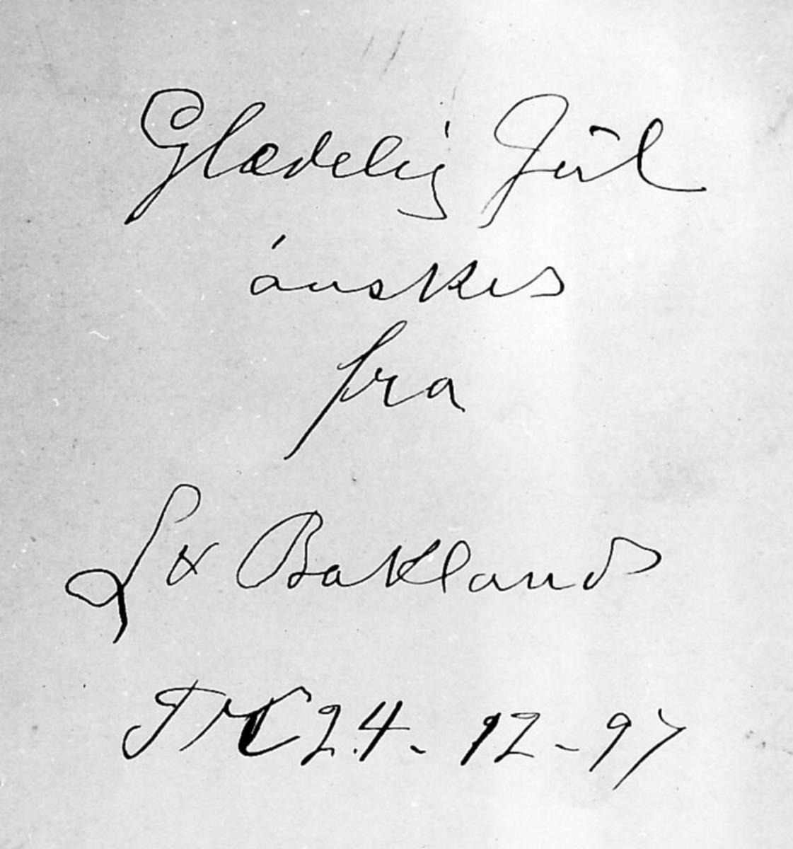 Bakside på bilde. Julehilsen skrevet av Ant. Løytnant Bakland? med håndskrift.