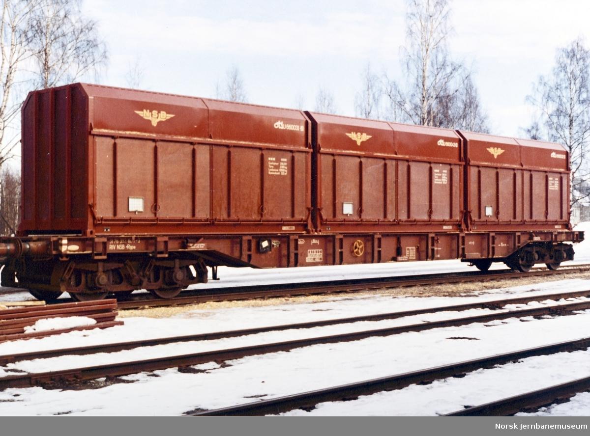 NSB plattformvogn litra Rgps 392 1071 med NSB-fliscontainere