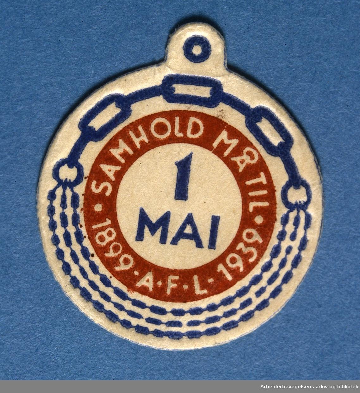 Arbeiderpartiets 1. mai-merke fra 1939, som.markerte Arbeidernes Faglige Landsorganisasjons 40-årsjubileum