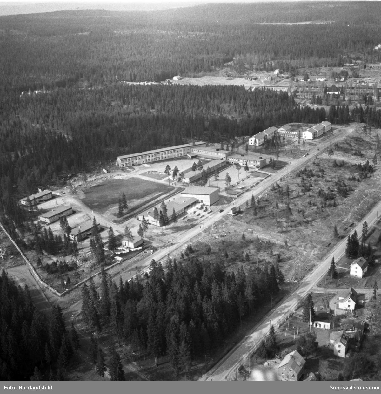 Flygfoto över Hagaskolan som ännu inte är helt färdigbyggd.