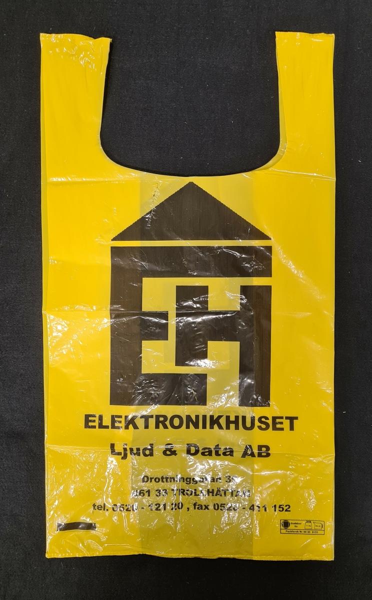 Plastkasse, gul, med logga från Elektronikhuset i Trollhättan.   På kassen står: EH Elektronikhuset Ljud & data ab  Drottninggatan 39 461 33 Trollhättan Tel. 0520-121 20, fax 0520-411 152