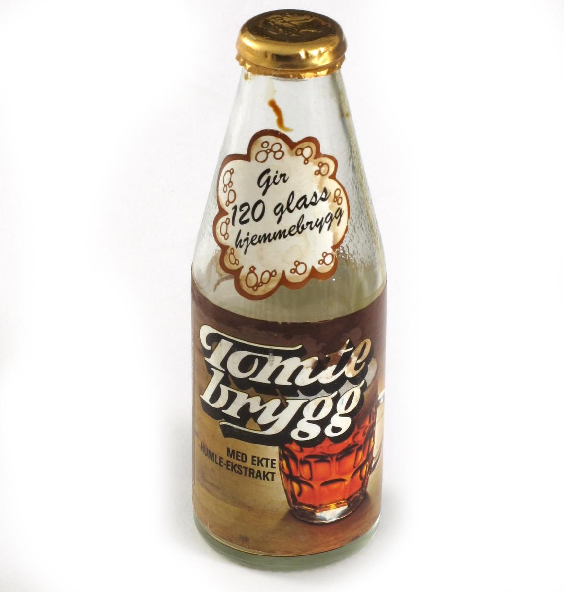 Glass med øl på etikett. Instemplet en nisse i kapselen.