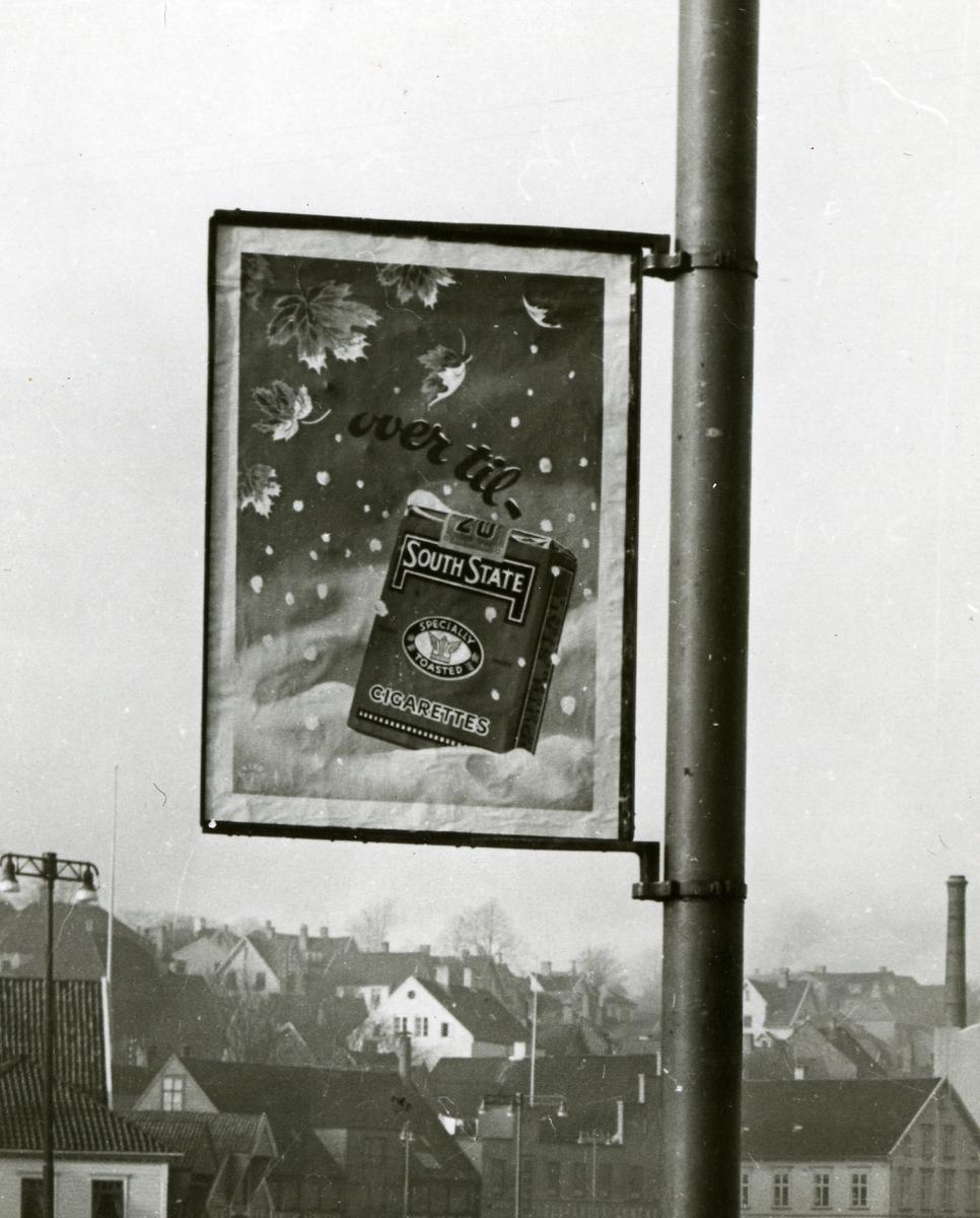 Plakat med reklame for South State sigaretter.