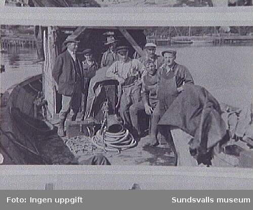 Dykare Nyberg på dykarbåt vid byggandet av Östrands sulfatfabrik, 1930.