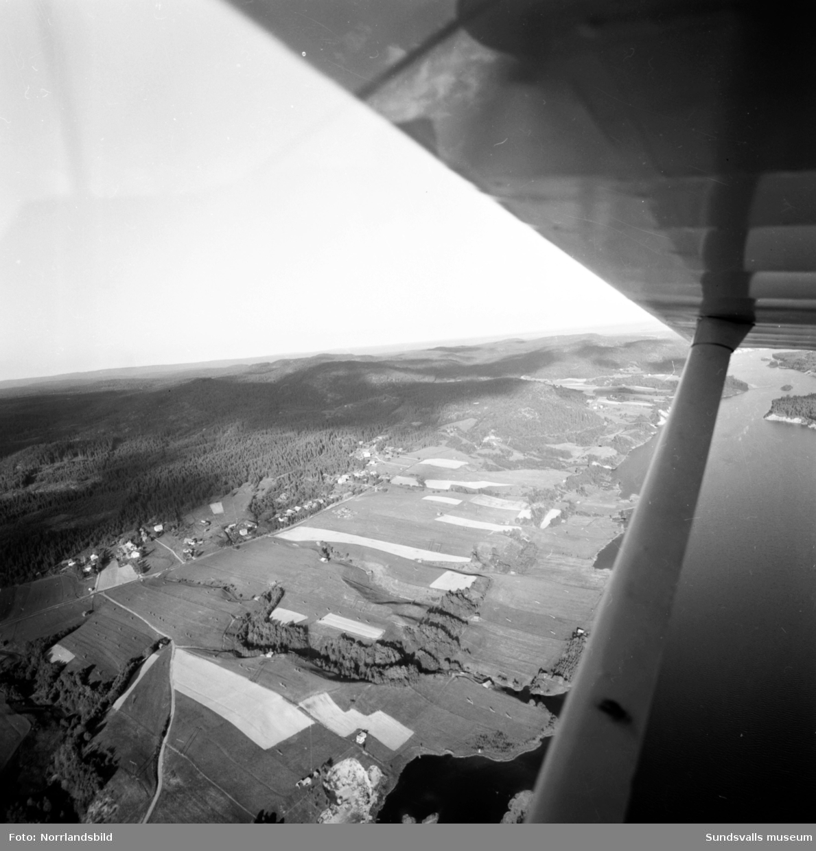Flygfoton över landsbygd och gårdar kring Östanskär, Indal.