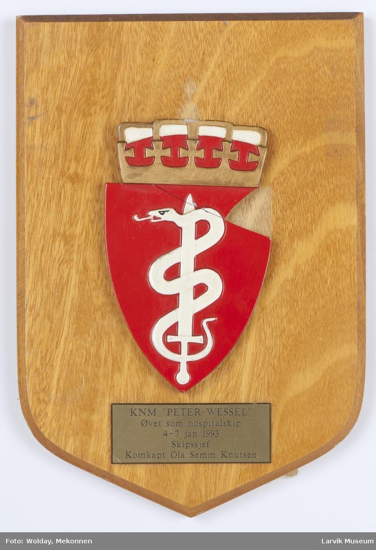 Plakett med løst skjold (hospital/medisin)) i to deler.