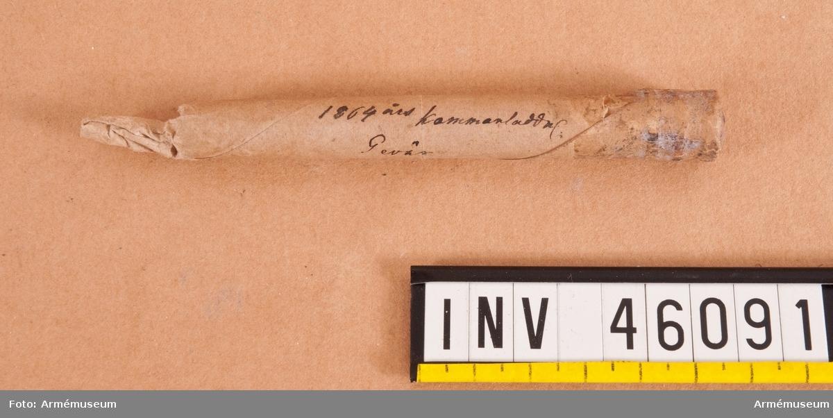 Grupp E V.  Skarp patron till räfflat kammarladdningsgevär m/1864.