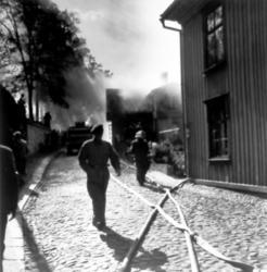 """""""Elden är lös vid Prästgårdsgatan""""."""