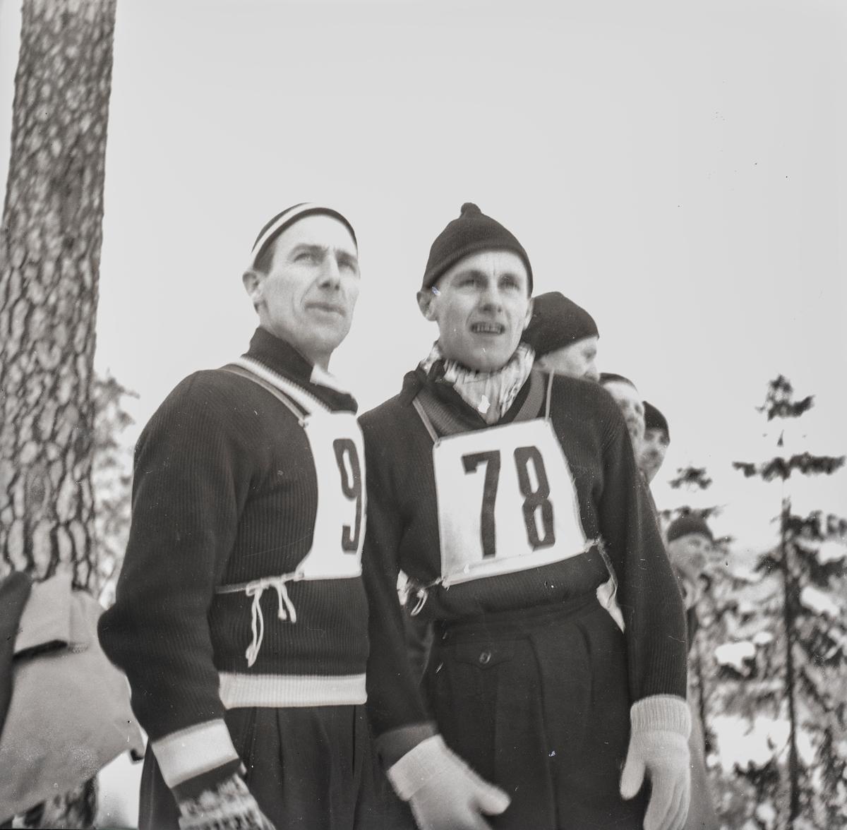 Two Kongsberg skiers