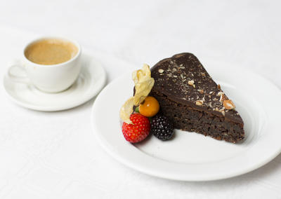 A cup of coffe and chocolate cake