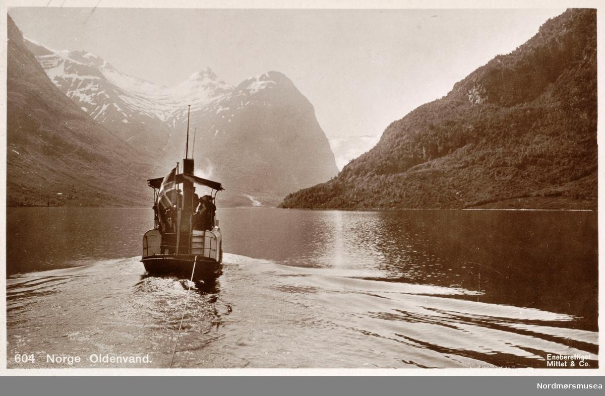 """Postkort: """"604. Norge. Oldenvann. Eneberettiget Mittet og Co."""" Fra et album med skadde bilder og postkort fra inn og utland. Bildet gjengies som et eksempel på bildet som en museumsgjenstand. Fra Nordmøre Museums fotosamling. EFR2015"""