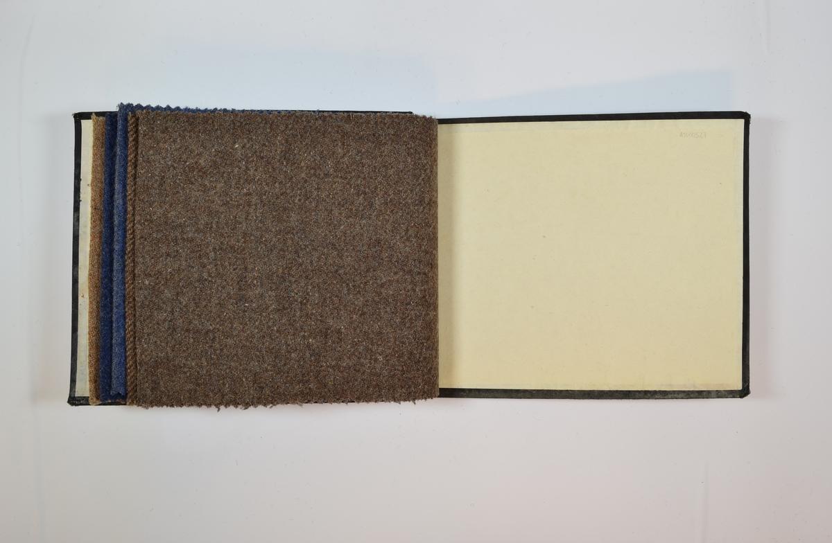 Prøvebok med 5 stoffprøver. Middels tykke melerte stoff med diskret skrå striper i vevmønsteret. Kyperbinding/diagonalvevd. Noe valket? Stoffet ligger brettet dobbelt i boken slik at vranga dekkes. Stoffene er merket med en rund papirlapp, festet til stoffet med metallstifter, hvor nummer er påført for hånd. Alle numrene er kysset over med rød fargeblyant.  Stoff nr.: 1805, 1808, 1809, 1813, 863/27.