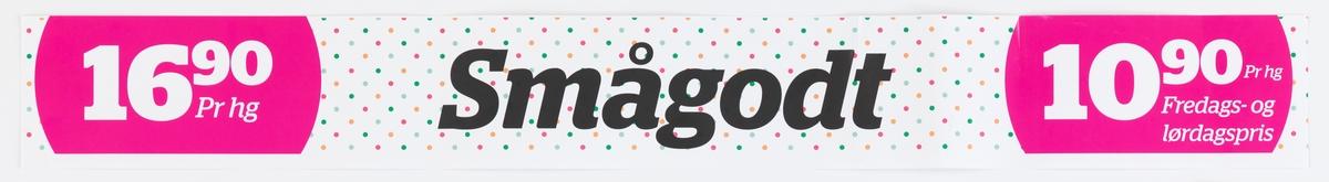 Butikkskiltet er en lang papirremse som kan settes opp i forbindelse med en hylleseksjon eller liknende. Skiltets bunnfarge er hvit med mange små prikker i fagene grøn, rød, oransje. Hvit tekst og pris i to rosa sirkler.