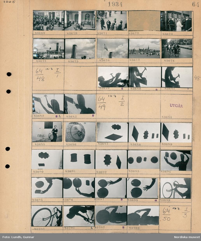 Motiv: Centralstationen; Människor i en vänthall, människor köar vid biljettluckor, detalj av ett fartyg, stadsvy med kaj med människor och fartyg och i bagrunden bebyggelse, gatuvy med cyklister som stiger på cyklarna.  Motiv: (ingen anteckning) ; Skuggbild av en man som slår in en spik med en hammare och drar ut den med en tång.  Motiv: (ingen anteckning) ; En man håller en papperslykta i handen, skuggor av papperslyktor på en vägg.