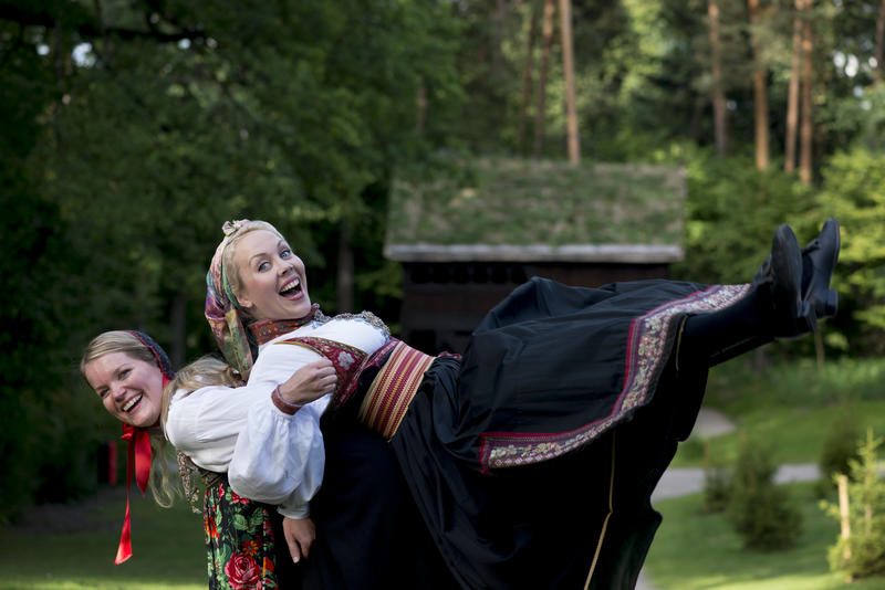 Hosts in folk dress from Hallingdal and Telemark in Norway
