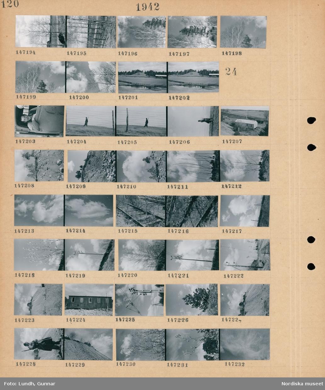 Motiv: (ingen anteckning) ; Träd, landskapsvy med vatten - åkrar och skog.  Motiv: (ingen anteckning) ; En man sitter i en bil, en soldat med gevär patrullerar bakom taggtråd, en byggnad vid en järnväg, landskapsvy med en kulle och träd, moln, ett övervuxet järnvägsspår, en björk, en elstolpe, exteriör av en byggnad, en soldat i uniform med gevär.