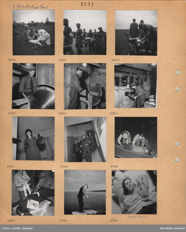 Motiv: Stockholm, beredskapsövning utomhus på ett fält, män i uniform och hjälm tar hand om skadad, hinkar fylls med vatten, kvinnor i overall och hjälm bär skadad på bår, man i overall och hjälm vid flyttbar maskin, man i skjorta, slips och keps kapar vedträn vid maskinsåg, lägger in vedträn i stor värmepanna, kvinna i kappa och hatt i trapphus slår på en gonggong, män och kvinnor går nerför en trappa inomhus, skadade tas om hand, kvinna med skylt som visar att vänster underben är skadat, man med metspön på en brygga, kvinnlig modell ligger i en säng, håller en bok.