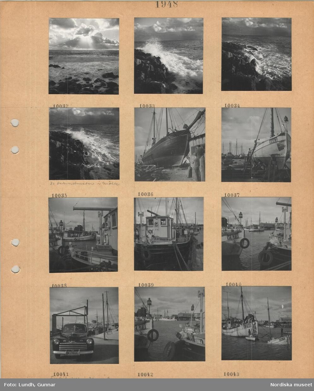 Motiv: Vågsvall vid klippig strand, molnformationer, 30 sekundmeter i Mölle, segelfartyg uppdragna på land, fiskebåtar i hamn, personbil på kaj, sjunken fiskebåt vid kaj.