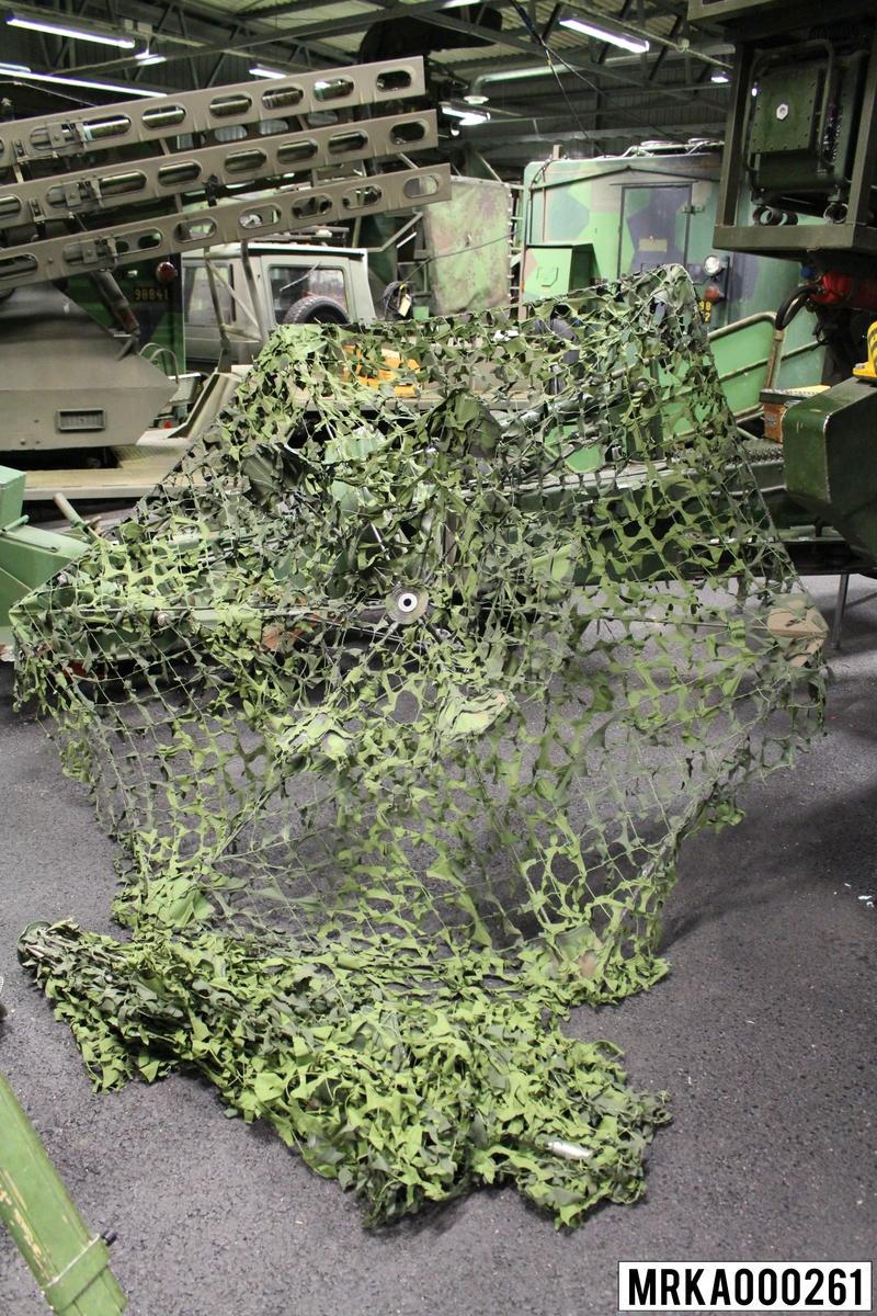 Maskeringsparasoll för artilleripjäser.