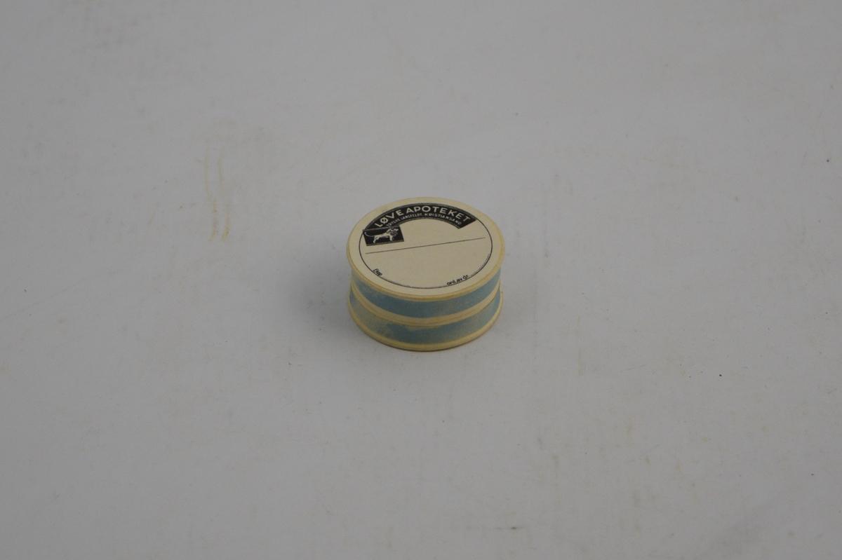 Sirkelformet pappeske med lokk.