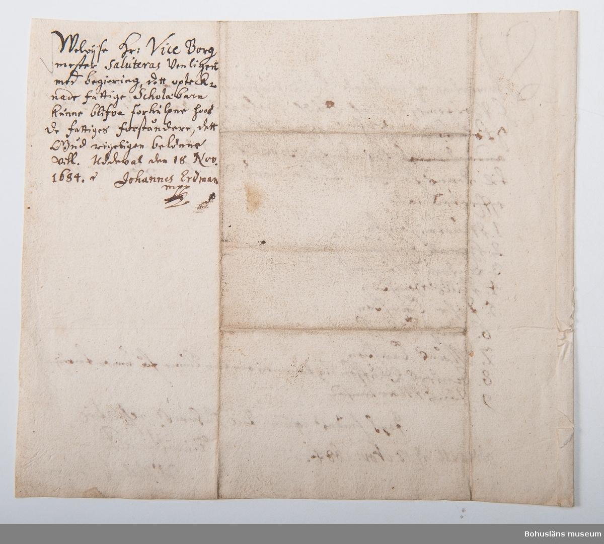 Skrivelse ang. utanordning av kläder till fattiga skolbarn i Uddevalla 18 november 1684.