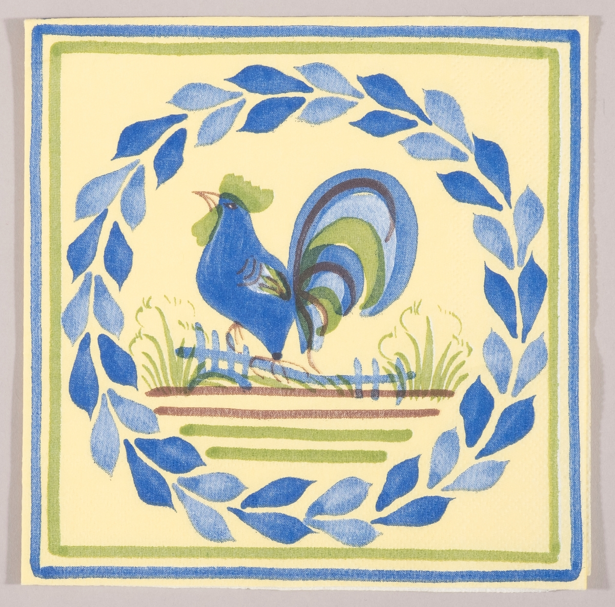 *en blå hane sitter på et gjerde. En rund krans av blå blader