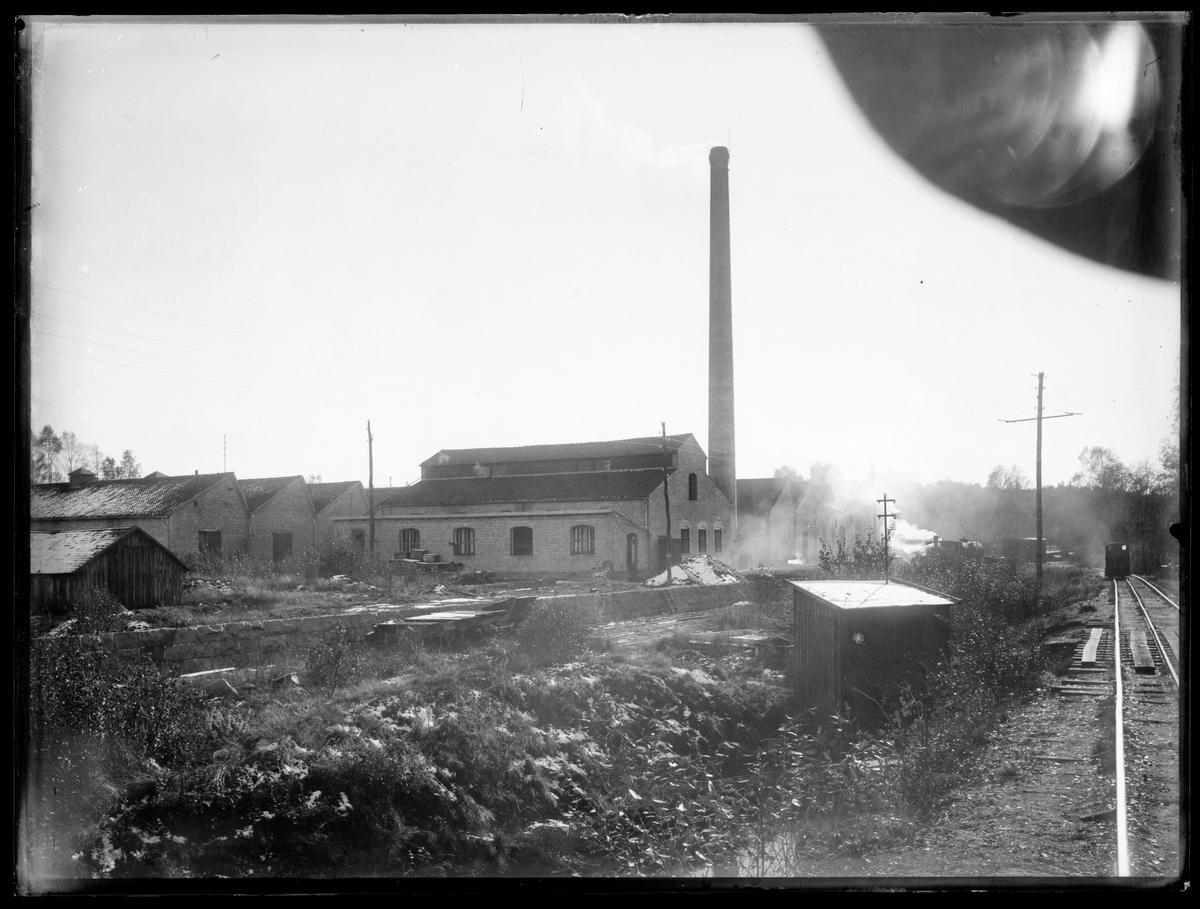 Bangård vid fabrik, möjligen vid Perstorp.