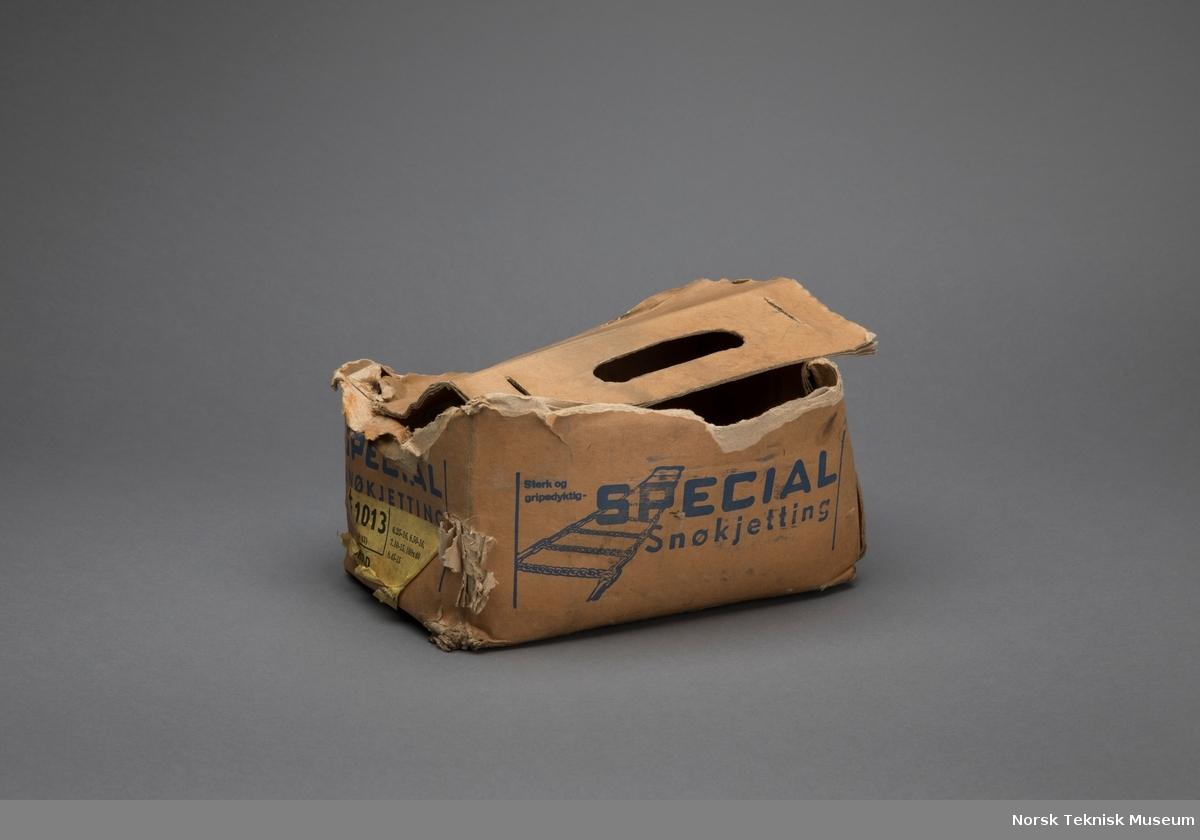 Kjetting i pappeske (original?). 2 stk gummislanger med kroker medfølger.