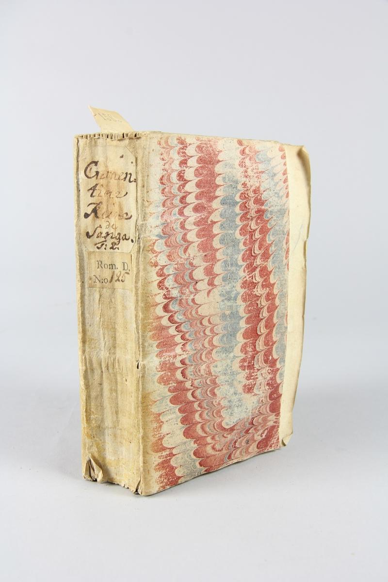 """Bok, häftad, """"Crementine, reine de Sanga, histoire indienne"""", del 2, skriven av de Gomez, tryckt i Haag 1739. Pärm av marmorerat papper, oskurna snitt. På ryggen klistrade pappersetiketter med volymens namn och samlingsnummer. Ryggen blekt."""