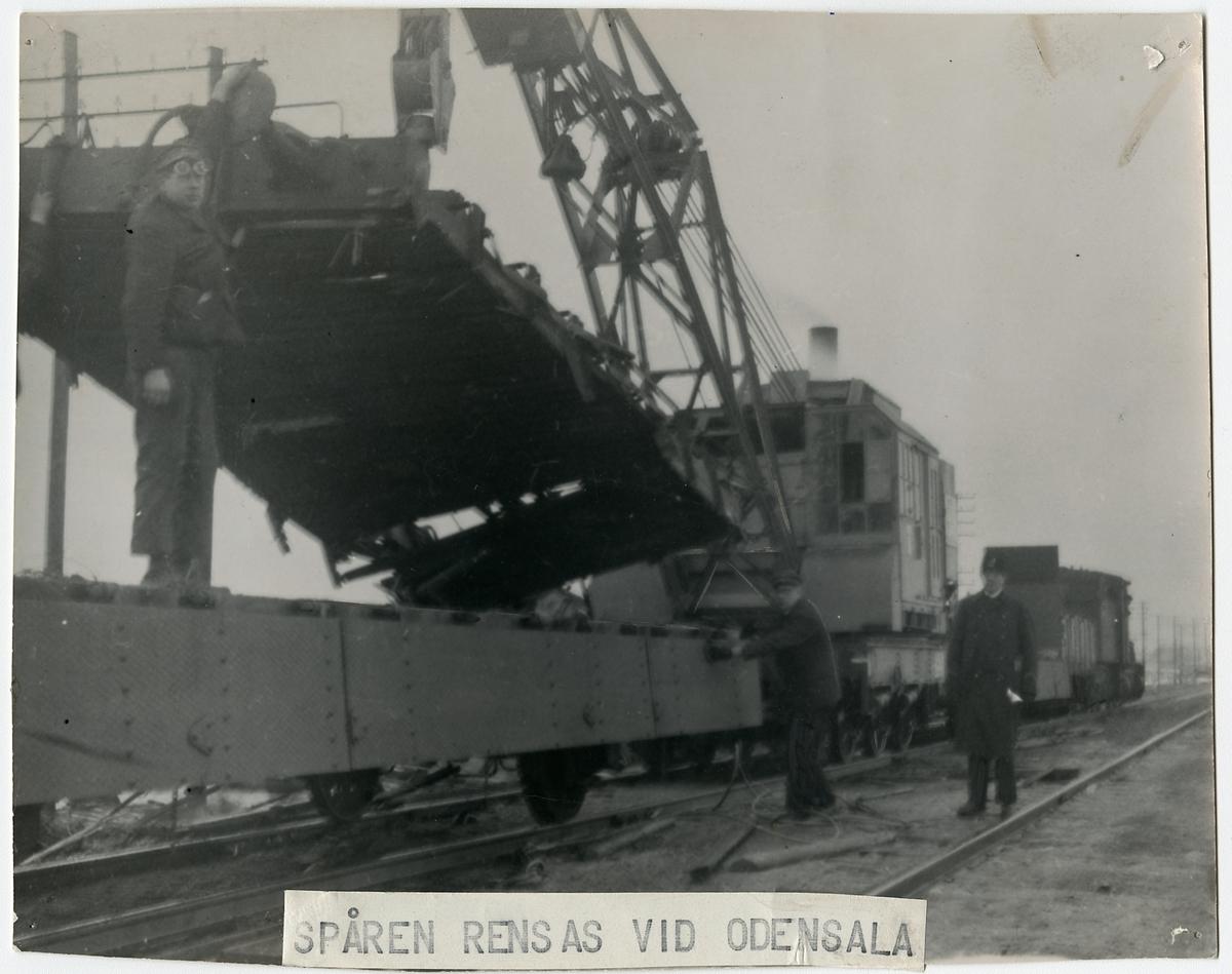 Pålastninga av en av vagnarnas underrede
