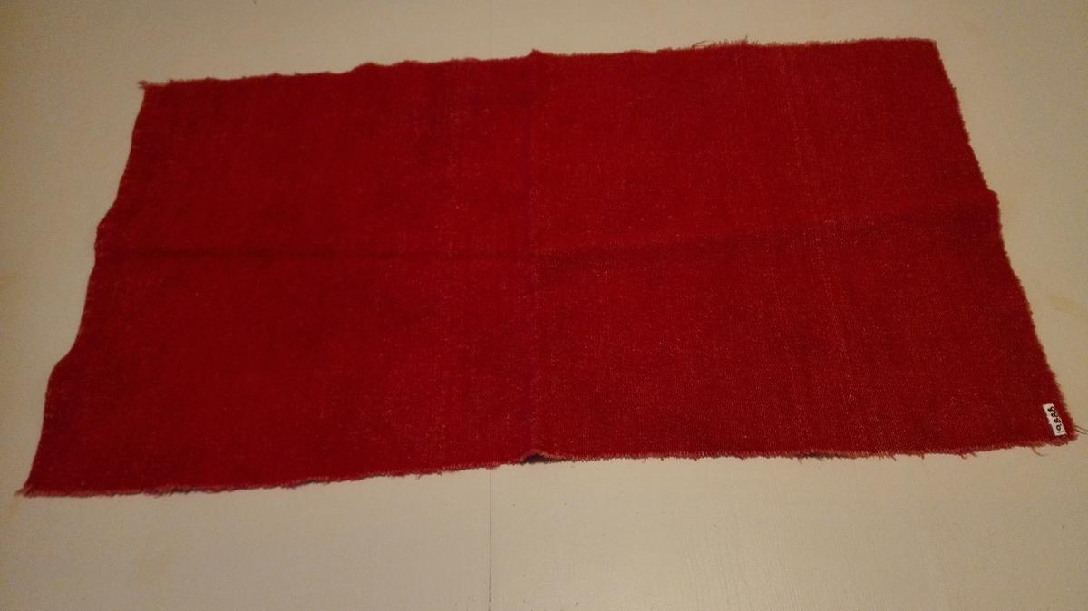 Tekstilstykke i to-skafts-binding med rosa renning og gamalrosa innslag.