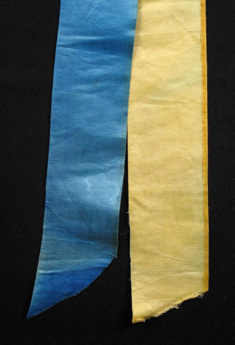 Begravelsessløyfe i gul og blå silke uten tekst.