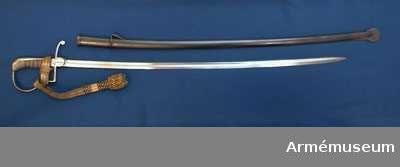 Grupp D II.  Balja är av brungjort järn och har bärinrättningm/1899.  På släpskons utsida står numret 67.   Samhörande nummer är AM.042726-AM.042727, AM.042888