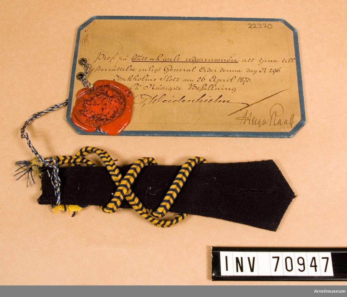 Grupp C.I. Prov på blått och gult redgarnssnöre att tjäna till efterrättelse enligt generalorder nr 296 den 26 april 1873.