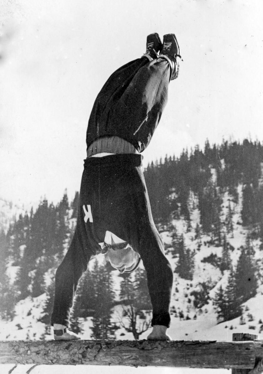 Norwegian athlete Birger Ruud showing off at Garmisch