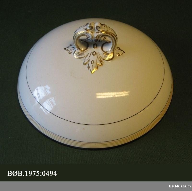 Form: Kuppelform med handtak på toppen