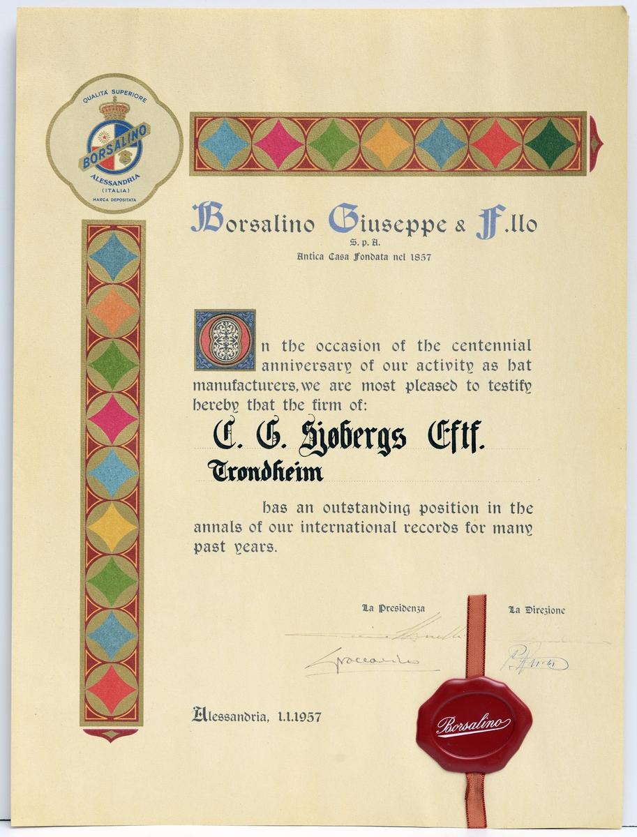 Lysegult papir med fargetrykk, håndskrevne signaturer og rødt lakksegl m. silkebånd.