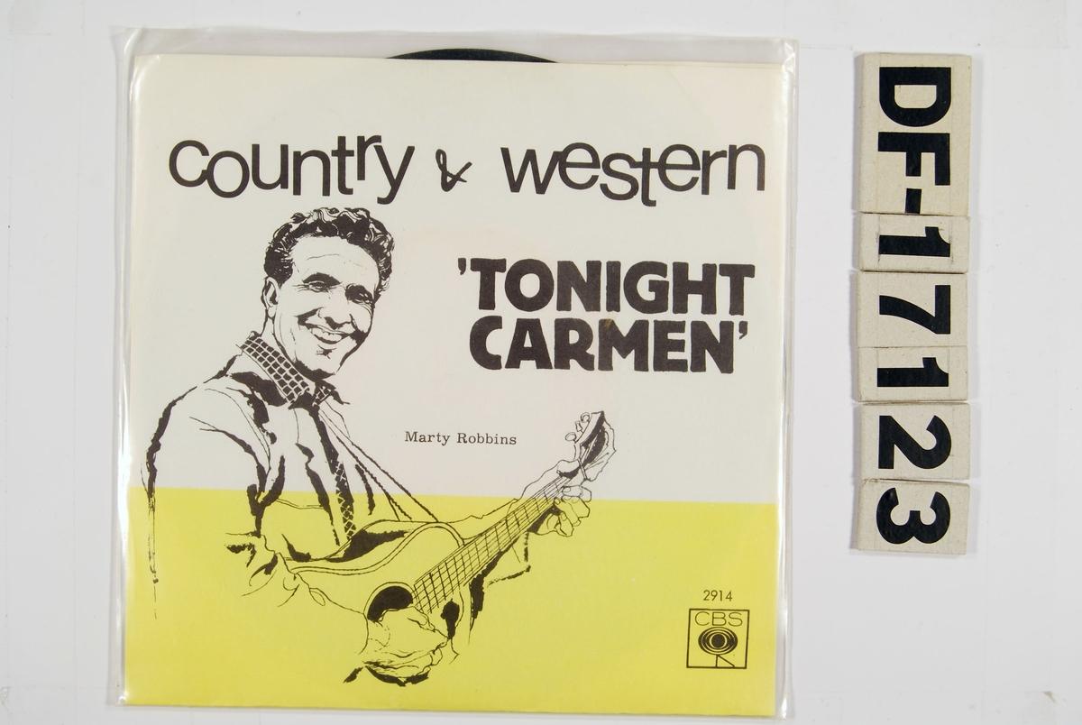 Tegning av Marty Robbins på coveret.