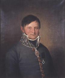 Portrett av Johan Collett. Mørk grå uniform, medalje i bånd om halsen, orden festet på brystet. (Foto/Photo)