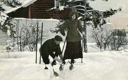 Postkort av  skiløpere brukt som julekort.