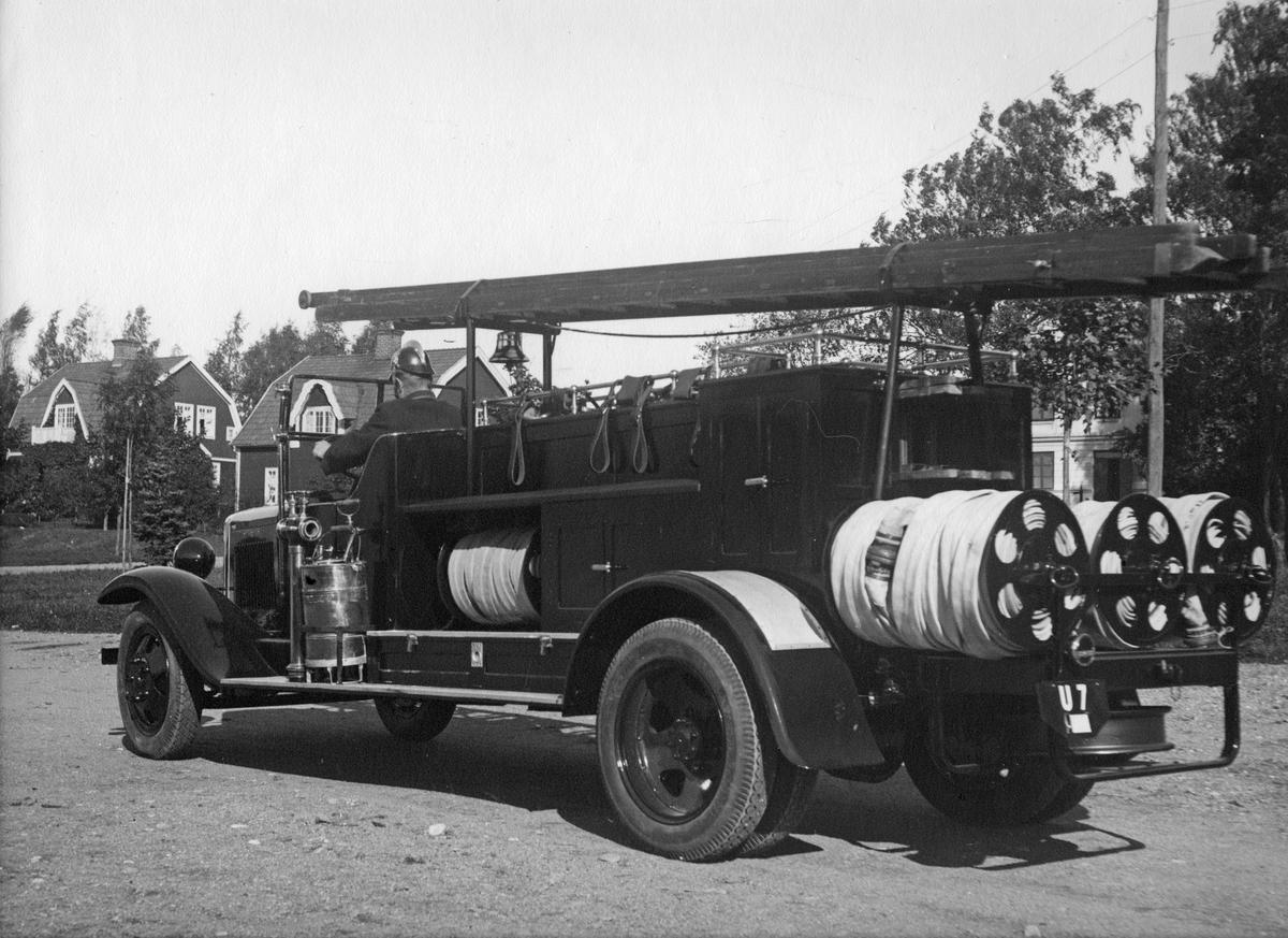 Köpings andra brandbil.I bilen Hugo Julle.