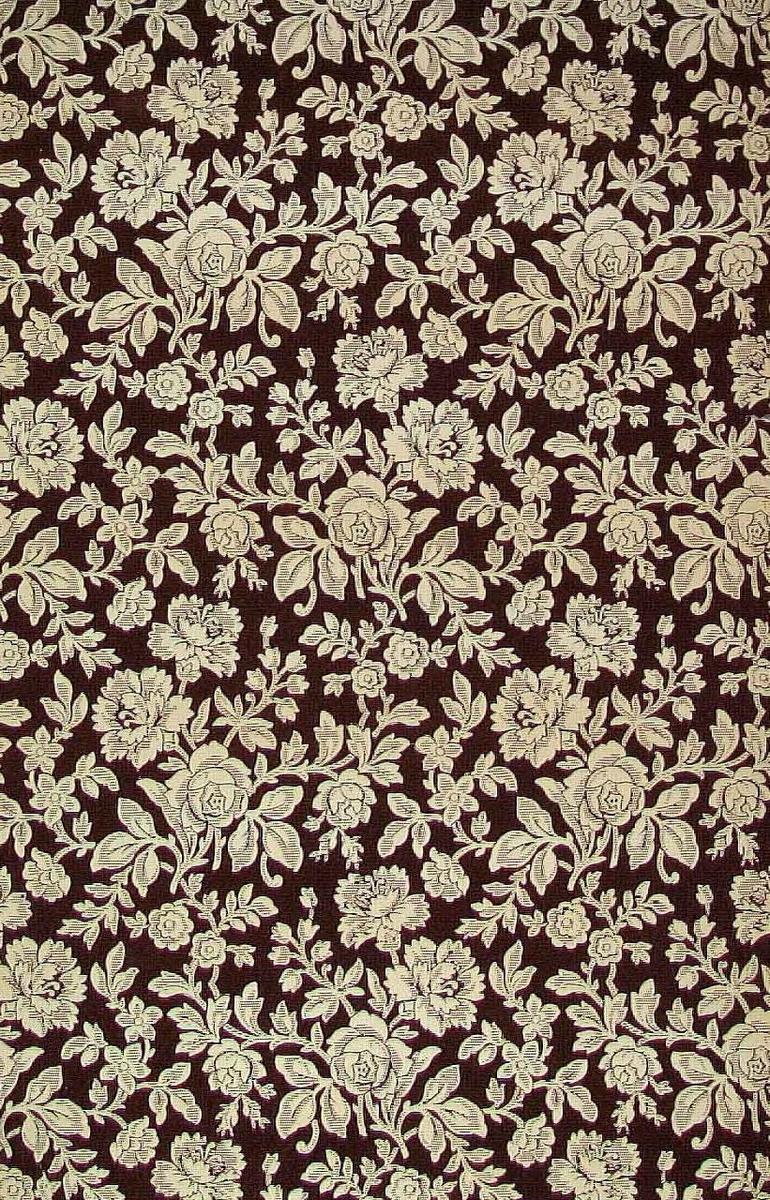 Ett ytfyllande delvis sgrafferat blommönster. Tryck i chokladbrunt på ofärgat papper.